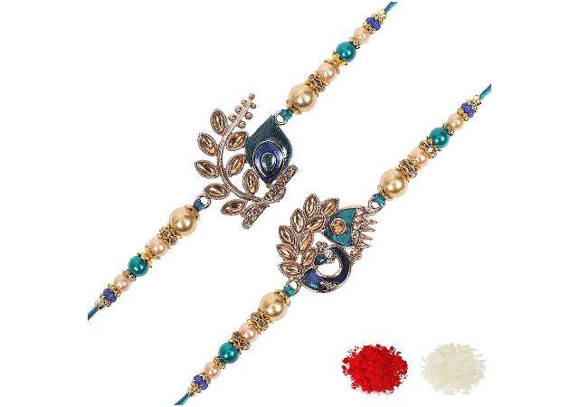 Riddhika Ventures Stylish Blue Peacock Feather and Royal Blue Peacock Kundan Rakhi (Set of 2) with Roli Chawal and Greeting Card (K2K3)